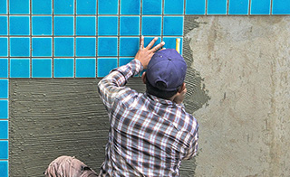 Man putting in tiles